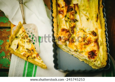 quiche with leek and a salmon. style rustic selective focus. the image is tinted - stock photo