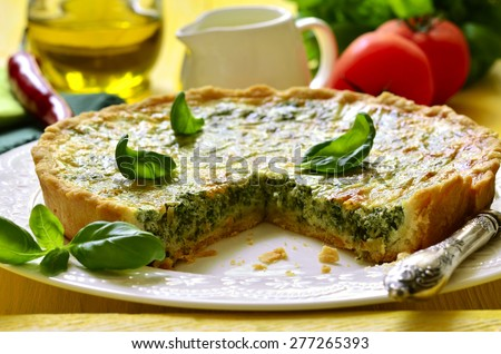 Quiche with spinach - traditional dish of french cuisine. - stock photo