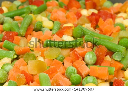 Quickly frozen vegetable mix (green peas, pepper, carrot, corn) - stock photo