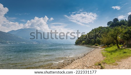 Quiet beach at Lake Como on a sunny day in September, Pianello, Lombardy, Italy - stock photo