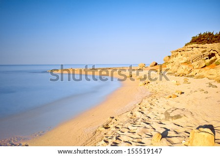 Quiet golden beach in Salento. Apulia. Italy. - stock photo