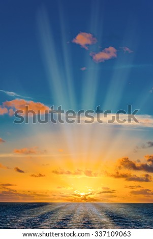 quiet morning sunrise over the ocean cloud sky - stock photo