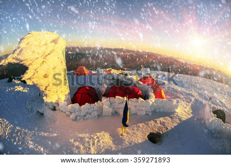 Quiet on the top of a frosty morning. Climbers tradition to celebrate the New Year holiday on the highest peak of Ukraine - Goverla, Montenegrin Mountains. Severe frost danger wind - stock photo