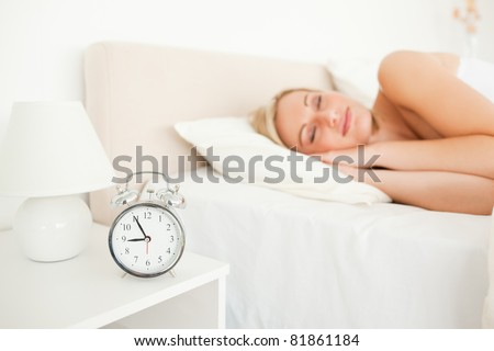 Quiet woman sleeping in her bedroom - stock photo