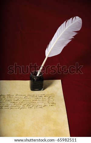 Quill, pen and handwritten text on parchment paper - Text is end of Abraham Lincoln's Gettysburg Address - stock photo