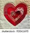 Quilt block with red and white Valentine heart design - stock photo