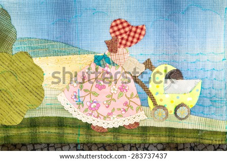 Quilt : Girl and baby - stock photo