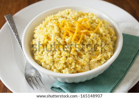 Quinoa and Cheese , quinoa grains with cheddar cheese - stock photo