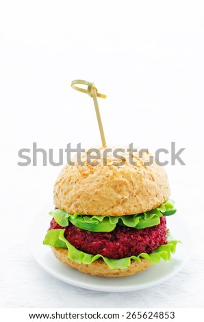 Quinoa, beet and chickpea burgers on a white background. tinting. selective focus - stock photo