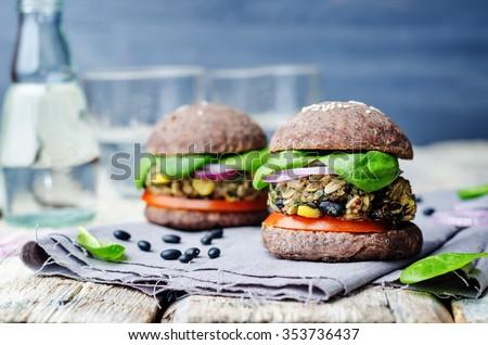 quinoa black bean spinach corn burgers with black beans bun crust. toning. selective Focus - stock photo