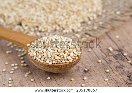 quinoa in a wooden spoon - stock photo