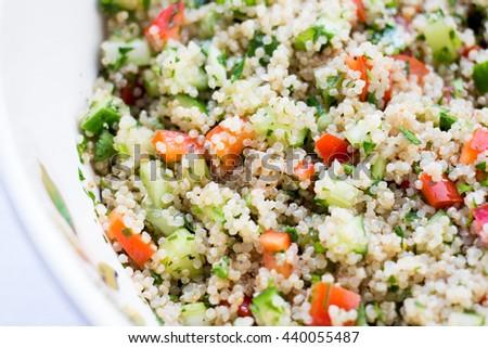 quinoa salad close up in a white bowl  - stock photo