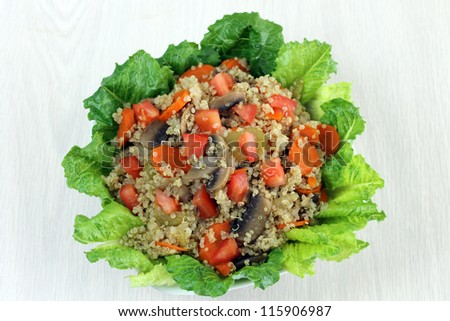 Quinoa Salad Overhead View with Carrots, Celery, Mushrooms, Tomato and Lettuce - stock photo