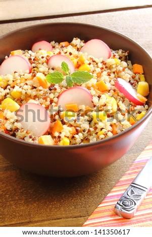 Quinoa salad with carrot, sweet corn and radish - stock photo