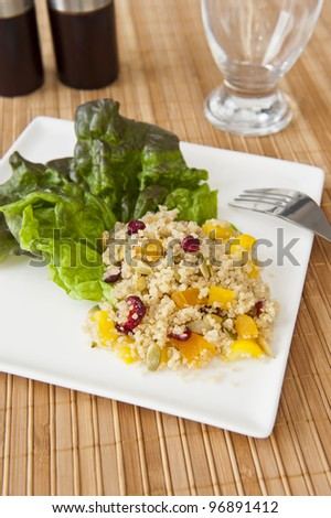 Quinoa salad with cranberries, apricots, peppers and pumpkin seeds - stock photo