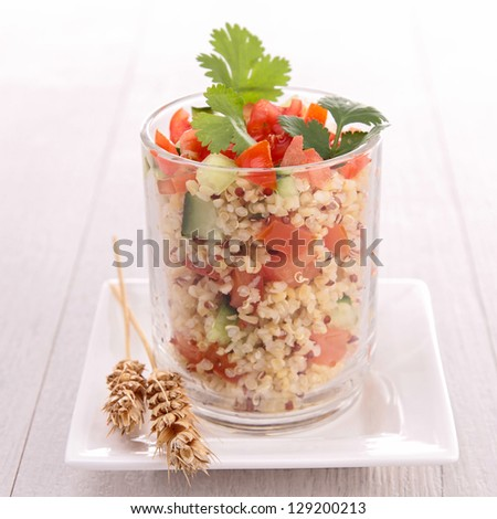 quinoa salad with cucumber and tomato - stock photo