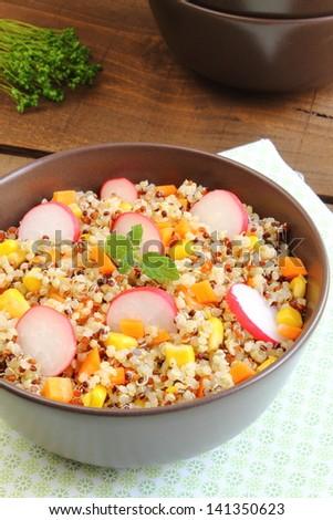 Quinoa salad with sweet corn, carrot and radish - stock photo