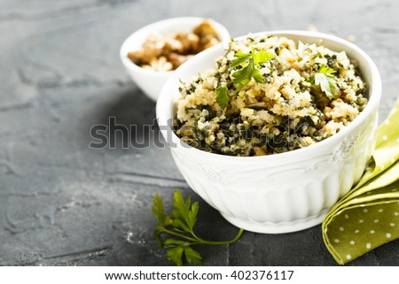 Quinoa salad with wild garlic and nuts - stock photo