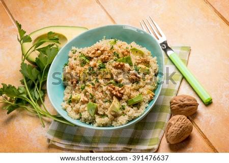 quinoa with avocado and nuts - stock photo