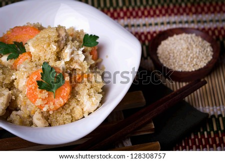 Quinoa with chicken and carrots - stock photo