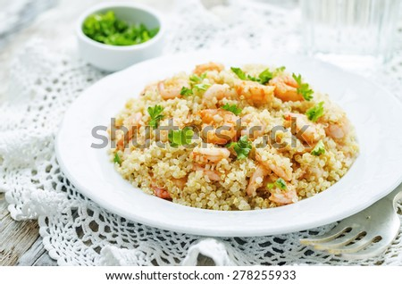 quinoa with shrimp and parsley on a white background. the toning. selective focus - stock photo