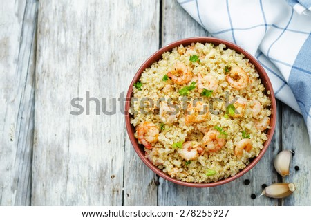 quinoa with shrimp and parsley on a white wood background. the toning. selective focus - stock photo