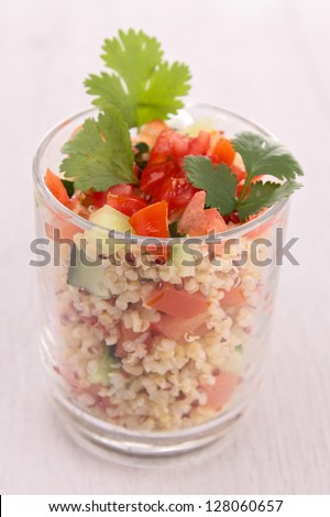 quinoa with tomato and cucumber - stock photo
