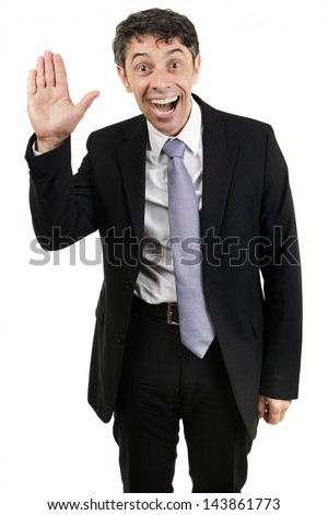 Quirky businessman with an animated expression and mouth open waving hello with the palm of his hand isolated on white - stock photo