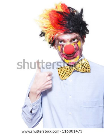 Quirky Circus Clown Performer Pointing Up To Blank Carnival Advertising Space Over White Background - stock photo