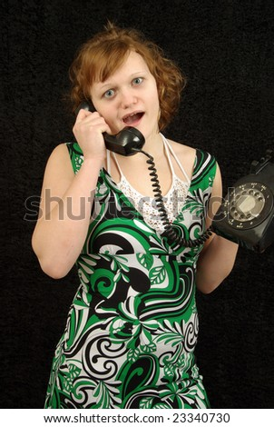Quirky girl talks on rotary phone - stock photo