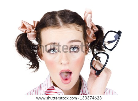 Quirky young businesswoman with shocked or surprised expression, white background - stock photo