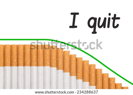 Quit smoking text with a graph of cigarettes and a red down trend line. - stock photo
