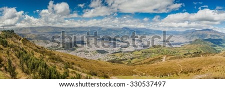 Quito, capital of Ecuador, as viewed from lookout Cruz Loma. - stock photo