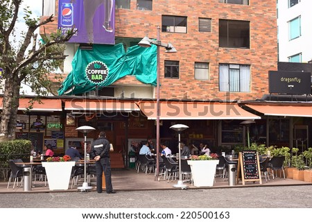QUITO, ECUADOR - AUGUST 6, 2014: Outdoor sitting area of the Coffee Bar restaurant on Plaza Foch in the center of the tourist district La Mariscal on August 6, 2014 in Quito, Ecuador.  - stock photo