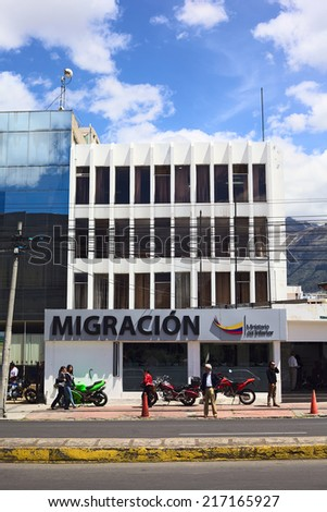 QUITO, ECUADOR - AUGUST 4, 2014: Unidentified people in front of the Migracion (Migration office) building on Amazonas Avenue on August 4, 2014 in Quito, Ecuador - stock photo