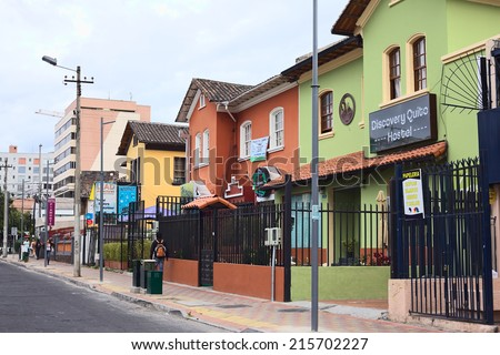 QUITO, ECUADOR - AUGUST 6, 2014: Unidentified people on Mariscal Foch Street in the tourist district with the hostels Discovery Quito and Piamonte along the road on August 6, 2014 in Quito, Ecuador - stock photo