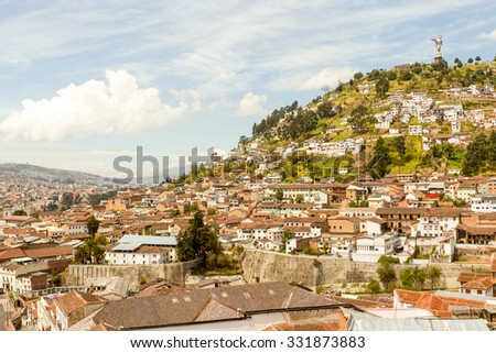 Quito Ecuador Cityscape With The Statue Of The Virgin On The Right Top This Point Is Dividing North From The South Of The City - stock photo