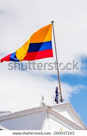 QUITO, ECUADOR - JAN 5, 2015: Unidentified Ecuadorian hussar establish the national flag of Ecuador in Quito. 71,9% of Ecuadorian people belong to the Mestizo ethnic group - stock photo