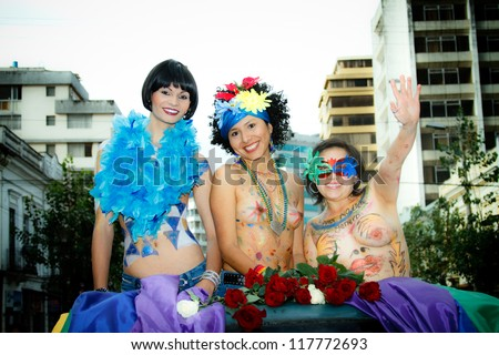 QUITO, ECUADOR JULY 03: Unidentified nude women participate Gay Pride parade, one of the famous gay parade in the americas. 2011, JULY 03, QUITO, ECUADOR - stock photo
