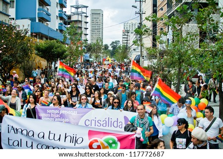 QUITO, ECUADOR JULY 03: Unidentified people participate in Gay Pride parade, one of the famous gay parade in the americas. 2011, JULY 03, QUITO, ECUADOR - stock photo