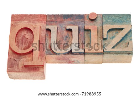 quiz word in vintage wood letterpress printing blocks, stained by color inks, isolated on white - stock photo