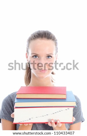 Quizzical student carrying textbooks student  carrying a pile of textbooks as she wonders whether she has made the right choice for her studies and whether she will be able to cope - stock photo