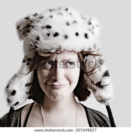 Quizzical woman in funny hat - stock photo