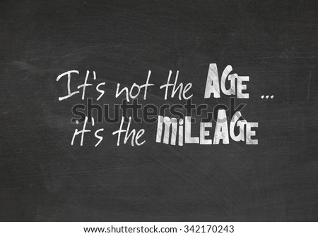 quote about age on dusty black chalkboard - stock photo