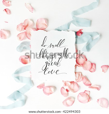 """quote """"Do small things with great love"""" written in calligraphy style on paper with pink petals and blue ribbon, flat lay composition - stock photo"""
