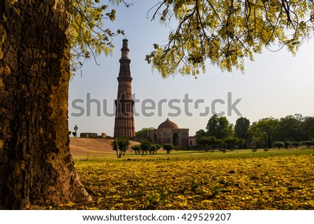 Qutub Minar, at 120 meters, is the tallest brick minaret in the world. The tower is located in New Delhi, India. - stock photo