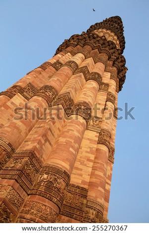 Qutub Minar tower against blue sky, Delhi, India - stock photo