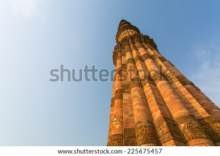 Qutub (Qutb) Minar, the tallest free-standing stone tower in the world, and the tallest minaret in India, constructed with red sandstone and marble in 1199 AD. - stock photo
