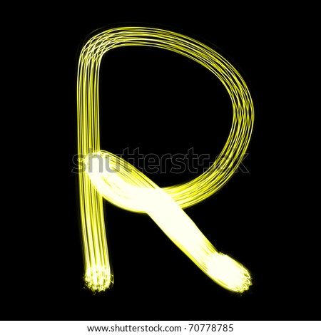 R - Created by light alphabet over black background - stock photo