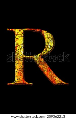 R fire letter cracked on black background - stock photo